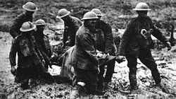 "British strectcher bearers. Pilckem Ridge (near Boesinghe), 1 August, 1917. Slogging through mud, they struggle to bring a wounded man out of the line. Casualty evacuation on First World War battlefields was extremely difficult at all times and never more so than during the notorious ""Passchendaele"" campaign."
