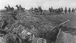 German cavalry cross the first set of British trenches  during the Ludendorff Offensive.